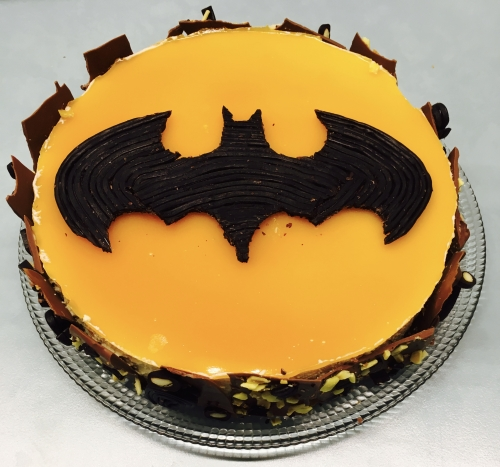 entremets, batman, croustillant sablé, abricot, mousse vanille, vanille, réglisse, coulis mangue passion